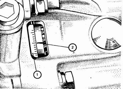 1 -шкала; 2 - метка на маховике.  Проверить и установить момент зажигания можно с помощью стробоскопа...