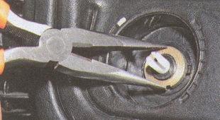 гайка крепления регулятора электрокорректора фар