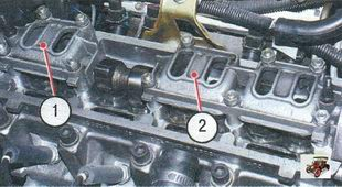 1 - четыре гайки крепления переднего корпуса подшипника распределвала; 2 - шесть гаек крепления заднего корпуса подшипника распределвала