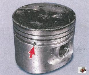 отверстия для стока масла в поршне