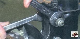 гайка регулировочного (верхнего) болта крепления телескопической стойки к поворотному кулаку Лада Калина ВАЗ 1118