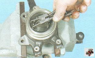 стопорные кольца подшипника ступицы в поворотном кулаке