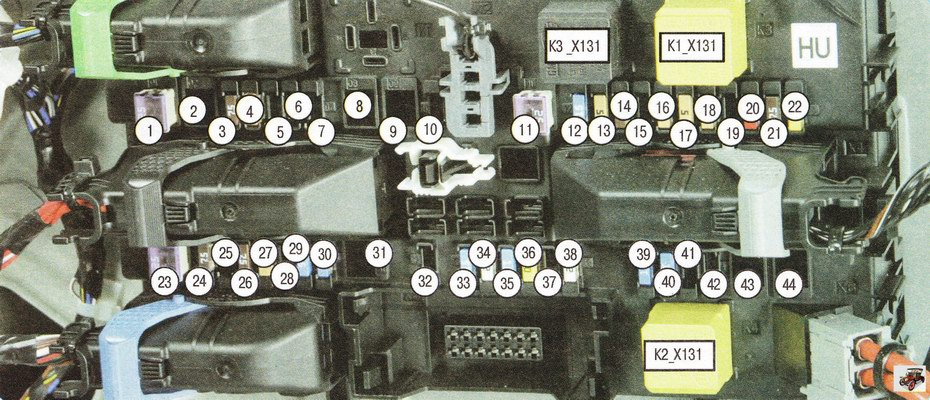 Обозначения предохранителей, плавких вставок и реле, установленных в монтажном блоке багажника Опель Астра Н