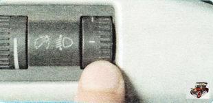 рукоятка регулятора корректора света фар