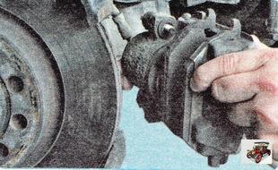 тормозной суппорт с тормозного механизма переднего колеса в сборе