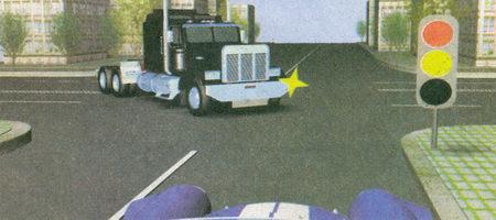 При включении зеленого сигнала светофора вы должны уступить дорогу грузовому автомобилю, не успевшему завершить разворот на перекрестке