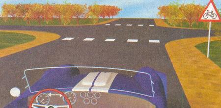 Знак 1.24 «Пересечение с велосипедной дорожкой» предупреждает вас о приближении к месту, где велосипедная дорожка пересекает дорогу...