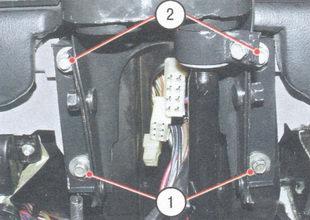 1 - болты и гайки крепления кронштейна рулевого вала к кузову, 2 - болты и гайки крепления кронштейна рулевого вала к кузову