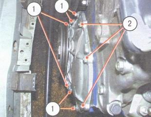 1 - болты, 2 - гайки крепления крышки привода распредвала